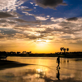 Last light by Mahul Mukherjee - Landscapes Sunsets & Sunrises ( water, walking, nature, sunsetman, cloud, man )