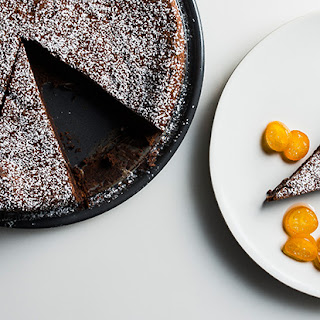 Chocolate and Chestnut Cake with Kumquat Sauce and Mascarpone Whipped Cream