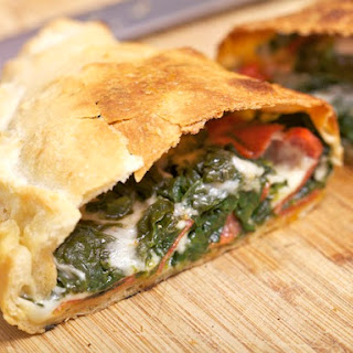 Spinach, Provolone, and Pepperoni Calzone.