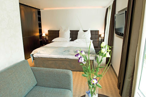 Scenic-Cruises-Contemporary-Accommodation - Guests on Scenic Cruises will find accommodations with contemporary interiors, a flat screen TV, couch, large bed and space to relax and enjoy the passing views.