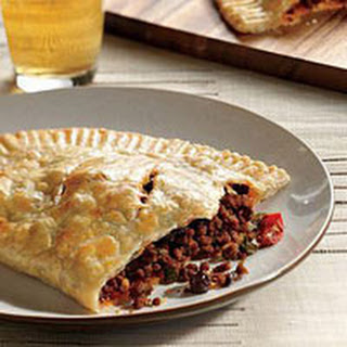 Beef Empanadas with Raisins and Pickled Peppers.