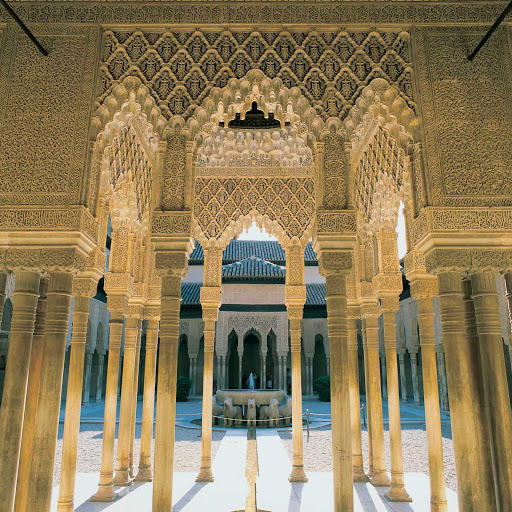 Patio de los Leones, part of the fortress and palace complex of Alahambra in Granada, Spain, has beautiful fountains and an ornate structural design.