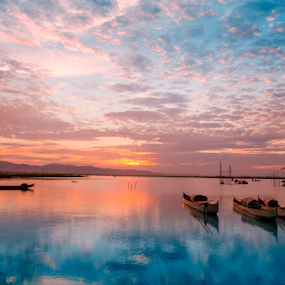 Afternoon in silent by Tamin Ibrahim - Landscapes Sunsets & Sunrises ( reflection, sunset, lake, boat, landscape )