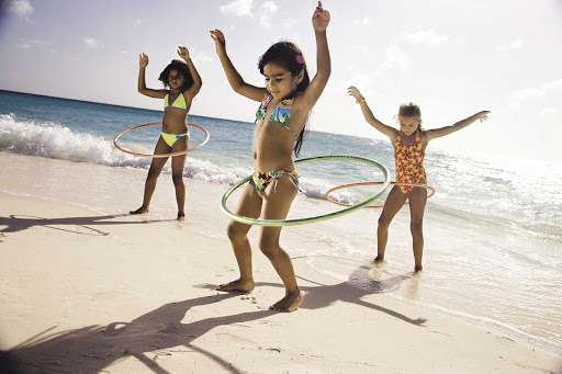 hula-hoops-Aruba - Kids get in some hula hoop action on the beach in Aruba.