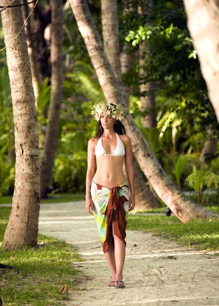 Walk through coconut groves and experience the tranquility of Bora Bora.