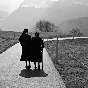 afternoon-stroll by Alex Ribowski - People Street & Candids ( nuns, stroll, mountains, afternoon, silhouette, road, Free, Freedom, Inspire, Inspiring, Inspirational, Emotion, , black and white, b&w, landscape, relax, tranquil, relaxing, tranquility )