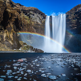 Skogafoss waterfall by Páll Jökull Pétursson - Landscapes Waterscapes ( south iceland, iceland, mountain, 2014, waterfall, canon eos 5d mkii, skógafoss, bigstopper, landscape, rocks, rainbow, longexposure,  )