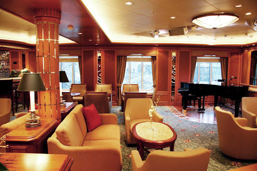 Cunard-Queen-Victoria-Chart-Room - Order a cocktail and mingle with guests at the Chart Room aboard Queen Victoria.