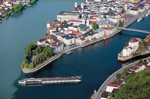 AmaPrima-in-Passau-Germany - The 164-passenger AmaPrima sails through Passau in Bavaria, Germany.