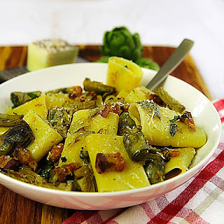 PACCHERI (TRADITIONAL MACARONI) with pork belly and baby artichokes.