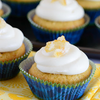 Vanilla Cupcakes with Lemon Curd Cream Cheese Frosting.