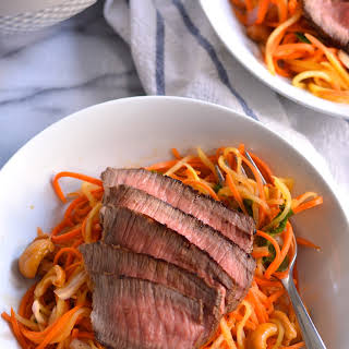 Steak Topped Carrot and Mango Salad with Chili Lime Dressing.