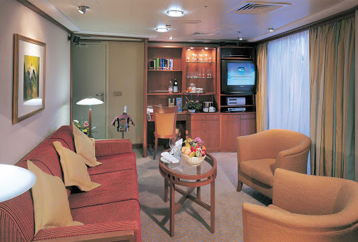 Norwegian-Sky-stateroom-Penthouse-living-room - Norwegian Sky guests can kick back and relax in the separate living areas of a Penthouse suite.