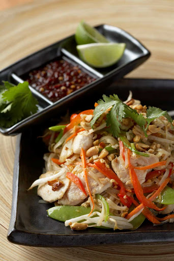 Silk_Harvest_pad_thai - Pad Thai accompanied by a garnish of lime, coriander and chilli served in the Celebrity Cruises restaurant Silk Harvest.