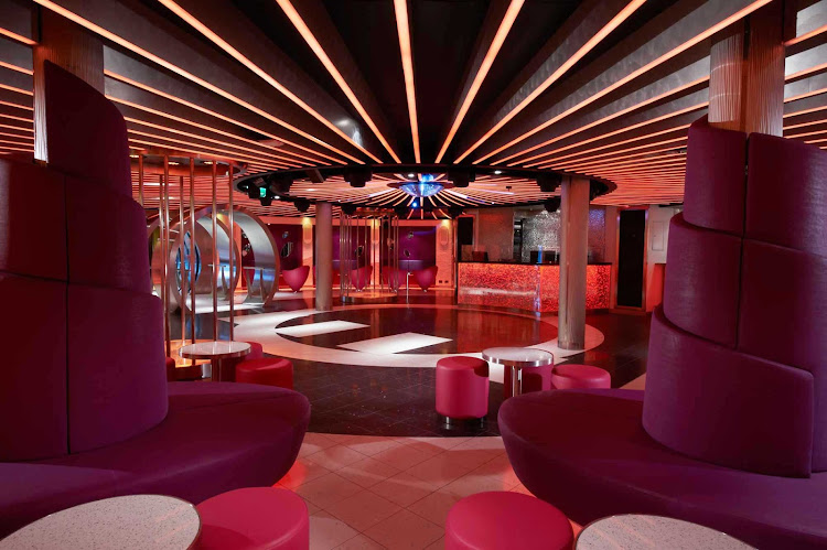 At night, head to the Liquid Lounge to grab a drink and meet new people when you sail on Carnival Breeze.