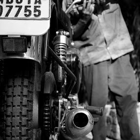 the mechanic by Jerry Sarkr - City,  Street & Park  Street Scenes