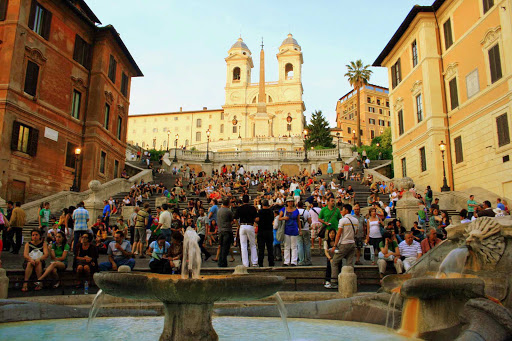 Spanish-steps-Rome - Sunset at the Spanish Steps (Scalinata della Trinità dei Monti) in Rome offers a perfect venue for people-watching. It's been a magnet for visitors since the 1700s.