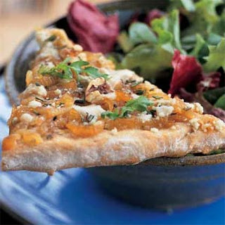 Caramelized Onion Pizza with Gorgonzola and Arugula.
