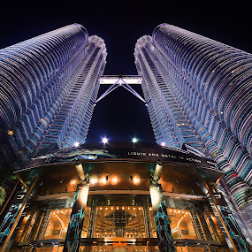 The Petronas Twin Towers, at the heart of the Kuala Lumpur city by Naďa Murmakova - Buildings & Architecture Office Buildings & Hotels ( skyline, centre, architecture, travel, capital, attraction, asian, city, center, light, financial, journey, malaysia, tourism, kl, destination, landmark, corporate, vacation, scene, town, shopping, view, kuala, famous, klcc, lumpur, development, scape, landscape, business, modern, twin, skyscraper, towers, asia, banking, trip, downtown, tall, office, building, petronas, malaysian, urban, tower, suria, night, finance, scenery,  )