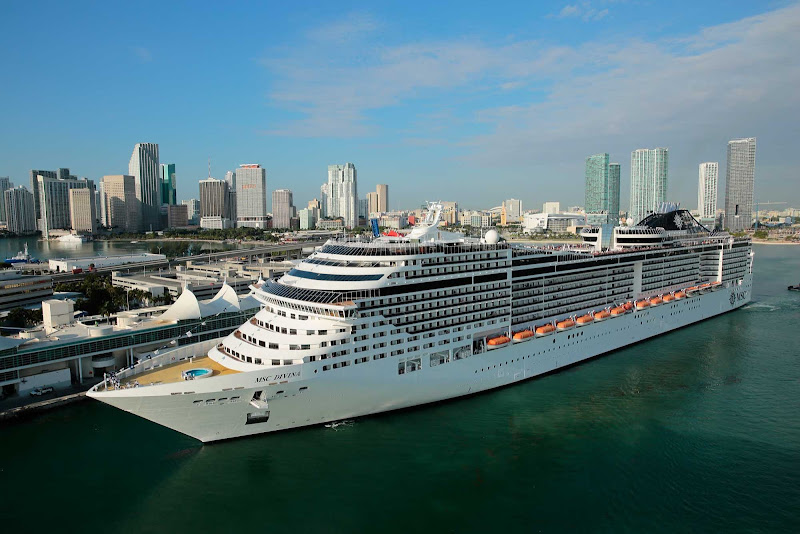 MSC Divina sails past the Miami skyline. The Divina, named in honor of actress Sophia Loren, features an infinity pool  overlooking the ship's wake, 150 fountains, a superb theater, water park and a choice of roomy suites.