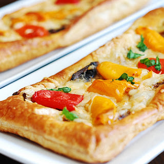 Puff pastry pizza with bell peppers, mushrooms, Mozzarella and Parmesan cheese.