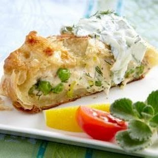 Salmon Wrapped in Pastry with Cucumber Sauce.