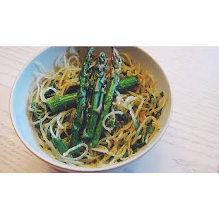 Kelp Noodles And Asparagus Tossed With Garlic, Pesto, Basil, And Avocado.