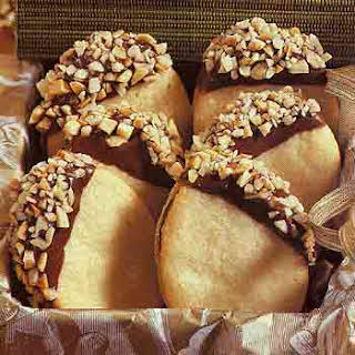 Chocolate- and Almond-Dipped Sandwich Cookies.