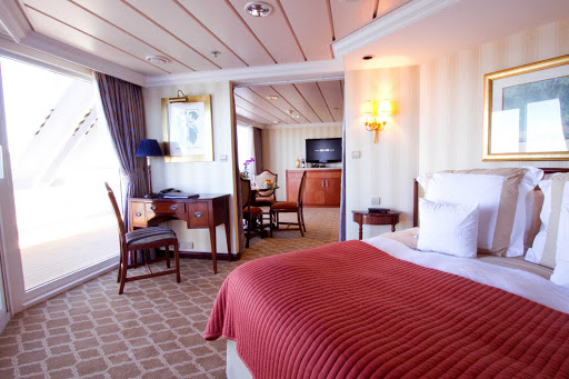 Azamara-Suite-27 - Stay in a large, airy suite with a veranda for watching the passing show while cruising with Azamara.
