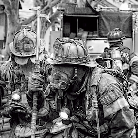 Ready to fight by Kati Garner - News & Events Disasters ( water, red, firetrucks, helmets, firefighters, hoses, fire )