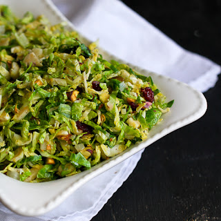 Shredded Brussels Sprouts with Pistachios, Cranberries & Parmesan