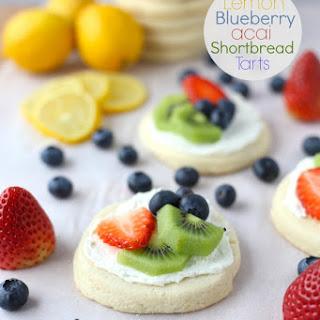 Lemon, Blueberry, Acai Shortbread Cookie Fruit Tarts.