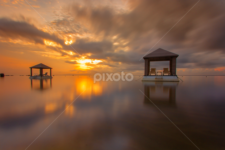 Sit and Relax by Choky Ochtavian Watulingas - Landscapes Sunsets & Sunrises ( clouds, pavilions, reflections, beach, seascape, sunrise, skies )
