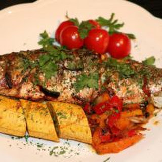Roasted Sea Bass with Roasted Plantain and Mixed Peppers Sauce.
