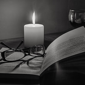 Books are medicine for soul by Petrea Ionut - Black & White Abstract ( candle, black and white, book, candle light, black )