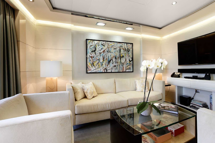 The classically designed Vista Suite lounge area aboard Oceania Marina.