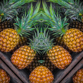 Pineapples at the market by Judith Dueck - Digital Art Things ( raw, plant, nutritious, diet, tropical, yellow, leaves, maui, hawaiian, vitamins, fresh, prickly, calories, pile, vegetarian, multiple, hawaii, dessert, fruit, mexico, mexican, shelves, delicious, stripes, health, snack, row, sale, many, organic, sweet, market, whole, food, background, outdoor, ripe, healthy, summer, eat, lines, pineapple, stack, group, sugar,  )