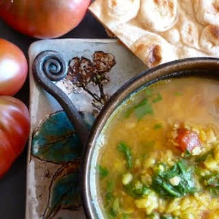 Spiced Yellow Dal with Tomatoes and Greens.