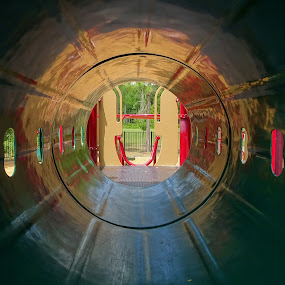 Look inside! by Judy Dean - City,  Street & Park  City Parks ( playground, reflection, park, tube, inside, play, toys, fun,  )