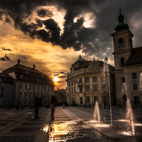 Sunset in Sibiu by Andrei Grososiu - City,  Street & Park  Fountains ( clouds, water, sky, sunset, fountain, romania, sibiu )