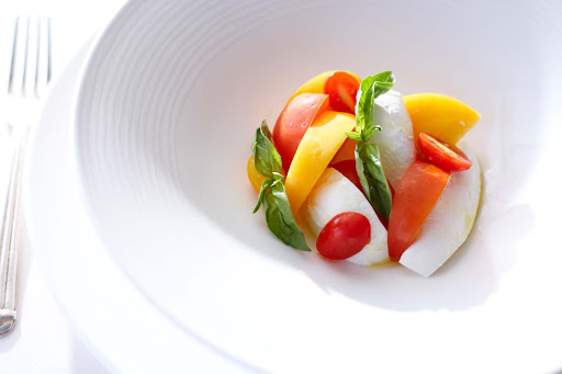 Culinary-Experiences-Caprese - A colorful Caprese is a good way to begin your meal aboard a Crystal cruise.