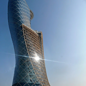 Abu Dhabi Capital Gate by Tamsin Carlisle - Buildings & Architecture Office Buildings & Hotels ( glint, tower, reflection, uae, leaning. design, abu dhabi, capital, sun, gate, , color, colors, landscape, portrait, object, filter forge, Urban, City, Lifestyle )