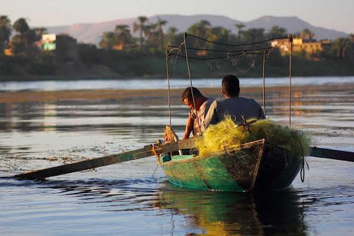 Fishermen on the Nile River in Luxor, Egypt.
