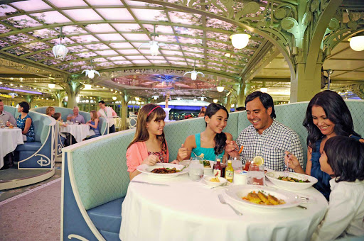 Disney-Cruise-Line-Enchanted-Garden-Family-in-booth - Enchanted Garden is one of three rotational main dining restaurants on the Disney Dream and Disney Fantasy. It's open for breakfast, lunch and dinner.