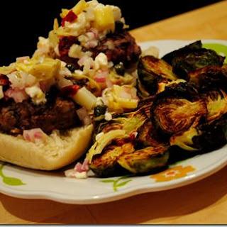 Mini Hamburger Sliders with Feta & Artichoke Salsa.
