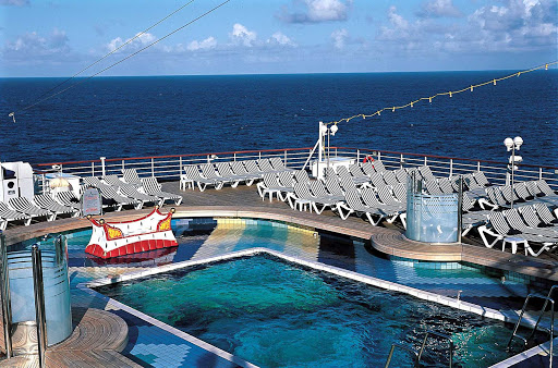 Have fun in the sun and take a dip in the Aft Pool aboard your Holland America cruise.