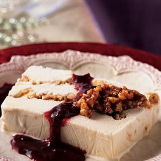 White Chocolate Praline Ice Cream Terrine with Blackberry-Raspberry Sauce.