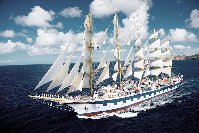 Crew and guests gather on the bow of Royal Clipper, the world's only five-masted full-rigged sailing ship.