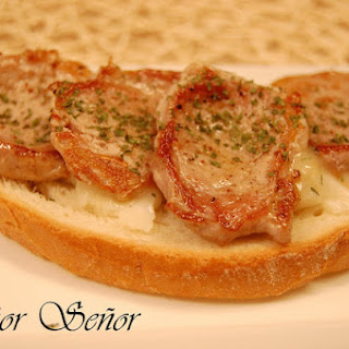 Iberian Pork Sirloin Steak over Toast with Torta del Casar Cheese.