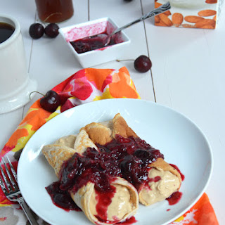 Peanut Butter Cheesecake Protein Crepes with Cherry Syrup.